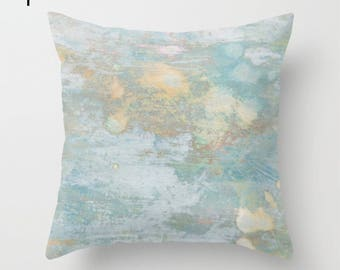 Modern abstract pillow, weathered look cushion in muted blues with worn paint effect, distressed look finish for coastal living room sofa