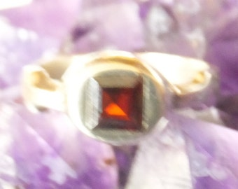 Garnet and Sterling Silver Ring.... size 7 only