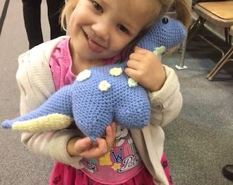 Crocheted dinosaur stuffed animal