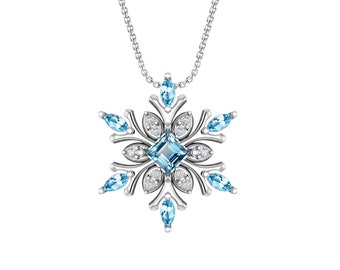 "Sterling Silver Snowflake Necklace with Swiss Blue Topaz Baguette Cut Center Stone and 18"" Rolo Chain"