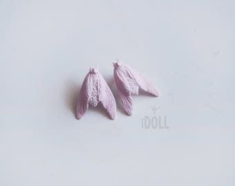 Earrings with pink moths.