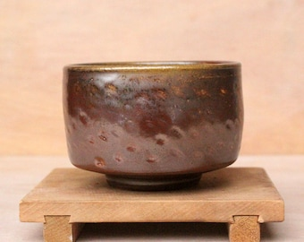Dark brown anagama fired tea bowl (chawan) with light dents