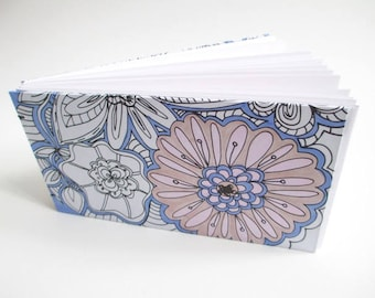 Repurposed coloring book page covered handmade coptic stitch sketchbook journal