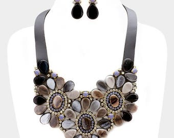 Faux leather back celluloid flower bib necklace