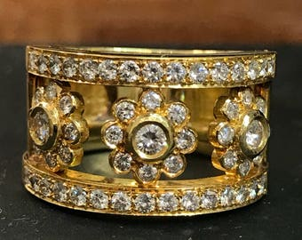 18k Gold Diamond Flower Motif Wide Ring. Sz 8 1/2, ring top is 13.5. Diamond approx. 1.00ctw. Weight 15.9grams.
