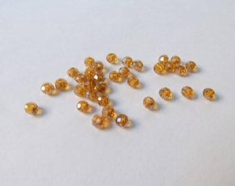 40 3mmx4mm glass facet beads amber highlights