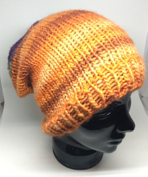 Purple and orange Medium weight slouchy handknit cozy hat. Bright fun colors. Adult size soft and loose.