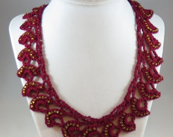 Red crocheted necklace with gold seed beads