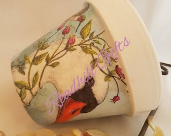 Hand decoupaged plant pot decorated with Swans with flowers