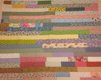 """This could be a Lap quilt or a toddler quilt, strip quilt, scrappy strips, 43.5"""" x 59.5""""  machine quilted"""