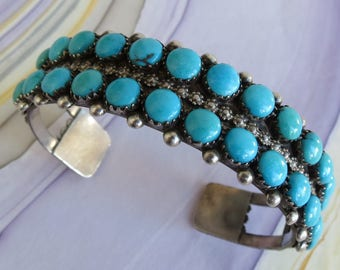 Double row sleeping beauty turquoise sterling silver vintage Zuni cuff bracelet by E Wyaco