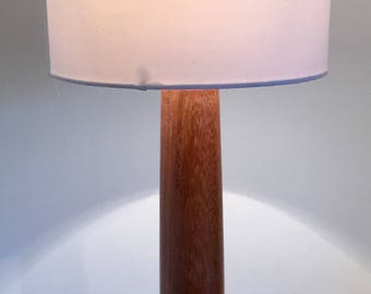 Modern, unique, hand turned wooden table lamp made from African Sapele wood. Bedroom, lounge, dining room.