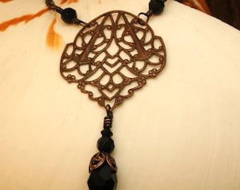 Black Crystal Filigree   ---   Vintaj Brass Filigree Shield Necklace With Black Crystal