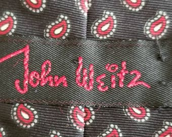 John Weitz 1980s vintage tie. Black Silk with red and white paisley print.
