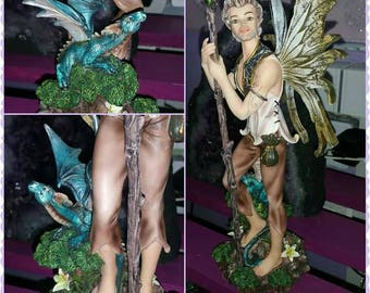 Elf and his dragon fairy polyresin