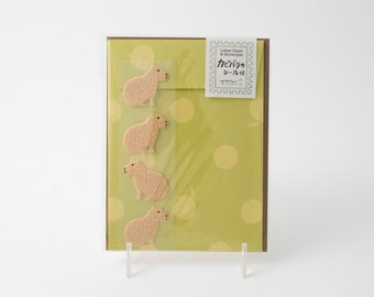 Midori capybara stationery set with letter paper, four patterned envelopes, and four envelope seals