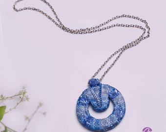 Unusual polymer clay circular marine style pendant  in shades of sea blue and white