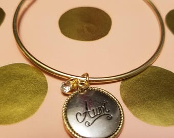 Gold expandable bracelet with silver and gold Aunt charm