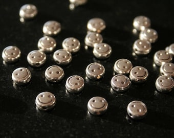 70 smiles silver-plated beads. (ref:2501).