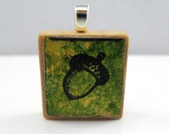Acorn in green - Glowing metallic Scrabble tile pendant