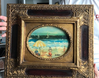 Antique oil beach scene painting on wood with antique gold frame