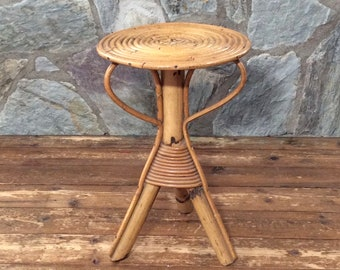 Small mid-century tripod rattan plant stand or side table with round top. Bohemian planter stool. Tropical, beach decor. Several in stock.