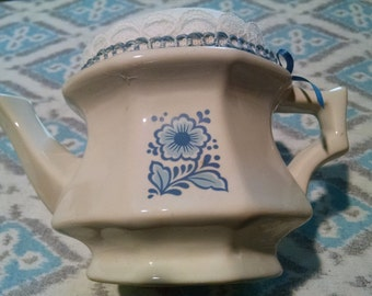 pincusion made from collectible avon teapot candleholder