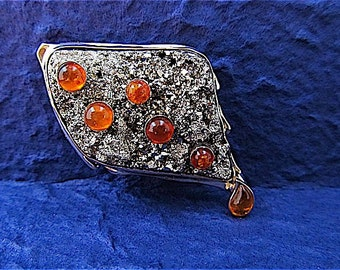 14k yellow gold pin with pyrite crystal and amber