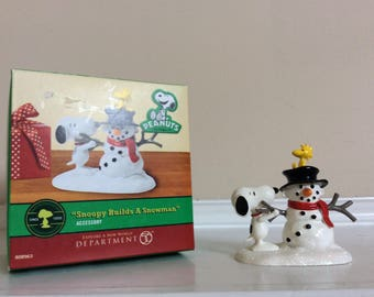 "Peanuts ""Snoopy Builds A Snowman"" figurine, Depart. 56."