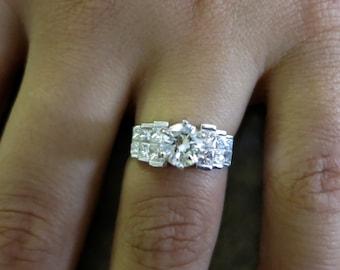 18K white gold round & princess cut diamonds.