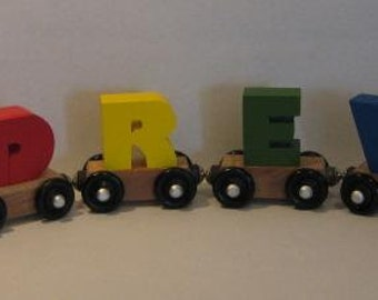 4 car Personalized Toy Train in Primary colors.