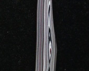Fordite cabochon, red black white gray, 14ct