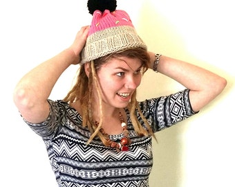 Donut hat. Hand knitted donut bobble hat with pink icing and sprinkles