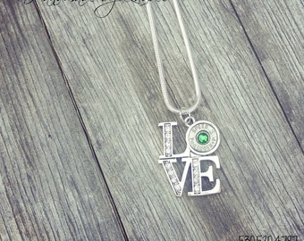 Love necklace with a silver 9mm casing on an 18 in chain