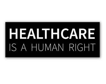 """1 """"Healthcare Is A Human Right"""" Black Bumper Sticker  - Indoor or Outdoor"""