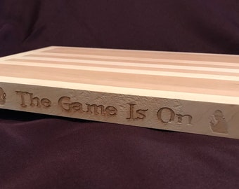The game is on • cutting board