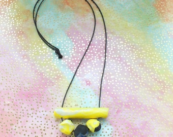 Small Yellow and Black Clustered Curve Clay Necklace