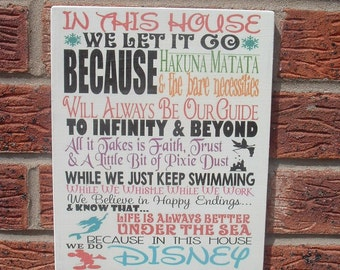 In this house we let it go  wooden sign plaque 10x8