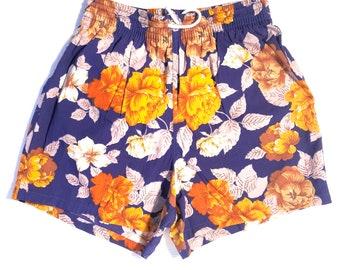 Vilebrequin VTG NOS swimming trunks, hawaiian style orange floral print over purple base