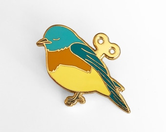 Wind Up Bird Enamel Pin
