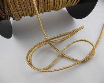 "1 meter of gold cord ""Cheerleader"""