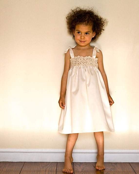 Lace flower girl dress in white or ivory for beach wedding.