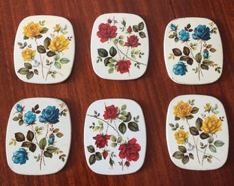 Vintage tin metal and cork coasters with floral motifs roses