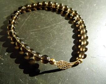 bracelet, symbol bracelet, smoky quartz, brown, wing, silver, gold plated