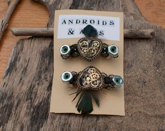 STEAMPUNK HEART CLIPS with resin set watch parts, feathers, nuts and bolts perfect for wedding or festival!