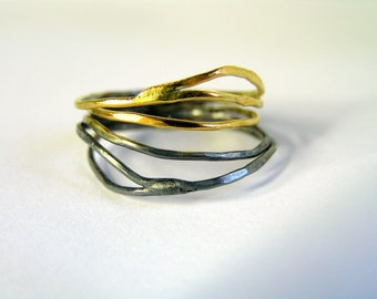 Black and gold sterling silver 4 ring set. Vine shape ring in oxidized and 24k gold plated sterling silver.