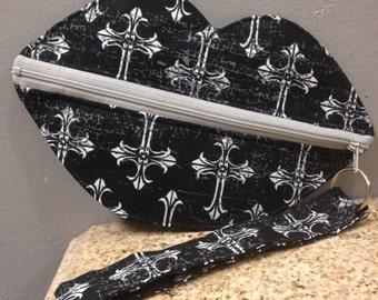 Lip wristlet with cross print, black with white crosses print