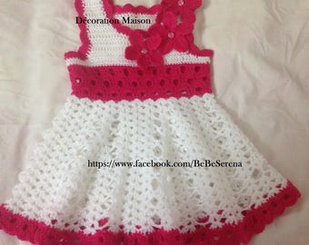Cute pink and white crocheted baby dresses