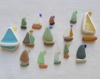 Pebbles, pottery fragments, polished sea glass and dishes. Sailboats, Supply for mineral board, Pebble art.