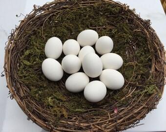 White ceramic bird eggs